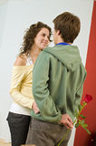 Teenager couple romance. Teenager boy giving rose to girlfriend Royalty Free Stock Images