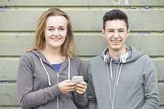 Teenager Couple Sharing Text Message On Mobile Phone Royalty Free Stock Photo