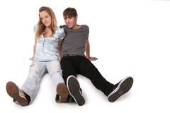 Teenager couple sit Stock Images