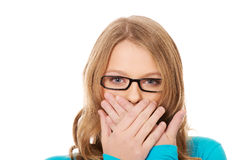Teenager covering her mouth Royalty Free Stock Photos