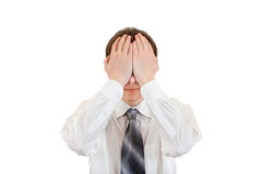 Teenager Covering his Eyes. Isolated on the White Background Royalty Free Stock Photo