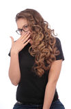 Teenager covering the mouth with her hand Stock Photo
