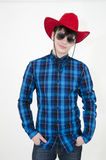 Teenager cowboy wearing sunglasses. Isolated on white background Stock Images