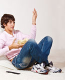 Teenager with crisps Stock Image