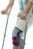 Teenager on crutches. With a knee bandage. isolated on white background stock photos