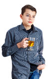 A teenager with a cup. Man drinks tea. Teenager with tea in hand. Man drinks tea. Teenager with tea in hand. A teenager with a cup. Handsome guy with coffee Royalty Free Stock Photography