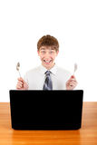 Teenager with Cutlery behind Laptop Stock Photos