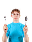 Teenager with Cutlery Stock Image