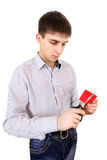 Teenager cutting a Credit Card Stock Image