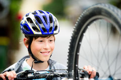 Teenager cycling. Teenager wearing a helmet and smiling Royalty Free Stock Image