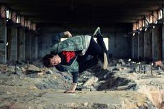 Teenager dancing break dance in the old brickworks Stock Photo