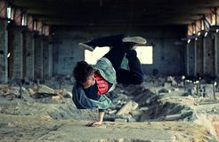 Teenager dancing break dance in the old brickworks Stock Photo
