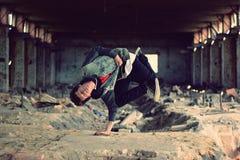 Teenager dancing break dance in the old brickworks Stock Images