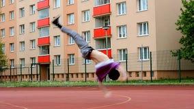 Teenager dancing break dance on the street. Teenager dancing break dance in the street stock video footage