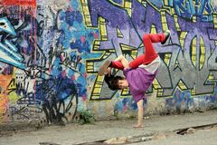 Teenager dancing break dance on the street Royalty Free Stock Photos