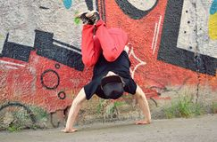 Teenager dancing break dance on the street Stock Photos