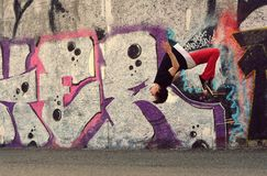 Teenager dancing break dance on the street Royalty Free Stock Images