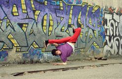 Teenager dancing break dance on the street Stock Photography