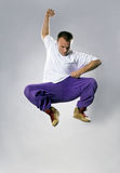Teenager dancing breakdance in jump Stock Photo