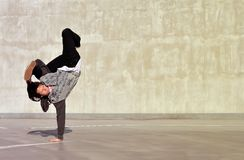 Teenager dancing breakdance on the street Stock Photography
