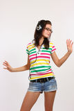 Teenager dancing with earphone Royalty Free Stock Photo