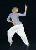Teenager dancing hip-hop in the darkness Royalty Free Stock Image