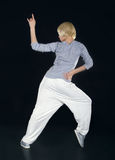 Teenager dancing hip-hop in the darkness Stock Photos