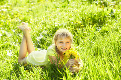 Teenager with dandelion bouquet Royalty Free Stock Images