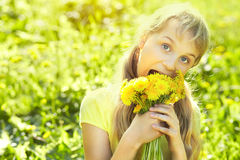 Teenager with dandelion bouquet Stock Photos
