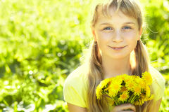 Teenager with dandelion bouquet Stock Image