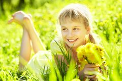 Teenager with dandelion bouquet Stock Photography