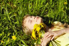 Teenager with dandelion bouquet Royalty Free Stock Photo