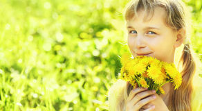 Teenager with dandelion bouquet Royalty Free Stock Photos