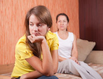 Teenager daughter and mother after quarrel. At home royalty free stock photography