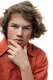 Teenager in deep thought. A young adult teenager scratches his chin in serious deep thought royalty free stock images