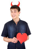 Teenager with Devil Horns and Heart. Cheerful Teenager with Devil Horns and Red Heart Shape on the White Background Stock Image