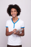 Teenager with digital tablet. Royalty Free Stock Images