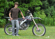 Teenager with dirt bike Stock Photos