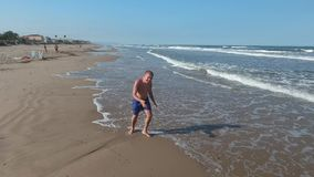 Teenager run around the sea. A teenager disabled child runs after foot surgery again. A happy moment of life and the joy of free running. The sun, the sea, the stock video