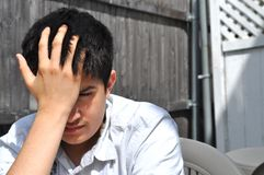 Teenager disperato Immagini Stock