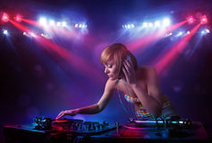 Teenager Dj mixing records in front of a crowd on stage Stock Photos