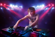 Teenager Dj mixing records in front of a crowd on stage Royalty Free Stock Photography