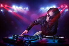 Teenager dj mixing records in front of a crowd on stage Royalty Free Stock Photos