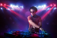 Teenager dj mixing records in front of a crowd on stage Royalty Free Stock Image