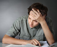 Teenager does homework Stock Image