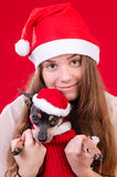 Teenager with dog in Christmas portrait Stock Photo