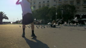 Teenager doing acrobatics on city square stock video footage