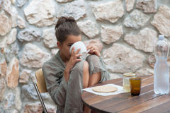 Teenager doing breakfast Royalty Free Stock Photography