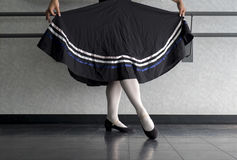 Teenager doing character ballet dance with skirt held in preparation. Position during ballet class at the dance studio Stock Image