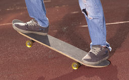 Teenager doing exercises on a skateboard Royalty Free Stock Images